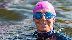 © Licensed to London News Pictures. 24/09/2016. London, UK. A participant warms up at the start of the first ever Swim Serpentine, held in the famous lake in Hyde Park.  Raising thousands for charity and with water temperatures of 18C, swimmers navigate the one mile clockwise route around the lake.  The two-day open water swimming festival includes the British Open Water Swimming Championships on Sunday. Photo credit : Stephen Chung/LNP