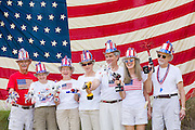 "Members of the ""Precision Drill Team"" pose in front of an American flag during the I'On neighborhood Independence Day parade July 4, 2015 in Mt Pleasant, South Carolina. The team parades using battery operated drills as their novelty."