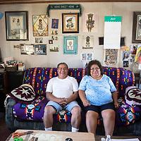 Zuni artists Carlos Laate, left, a Zuni Pueblo potter and his wife Roxanne Seoutewa, a Zuni Pueblo Petti-point silversmith in their home studio Thursday, July 4 in Zuni.