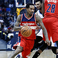 08 March 2017: Washington Wizards guard Brandon Jennings (7) drives past Denver Nuggets guard Jamal Murray (27) on a screen set by Washington Wizards center Ian Mahinmi (28) during the Washington Wizards 123-113 victory over the Denver Nuggets, at the Pepsi Center, Denver, Colorado, USA.