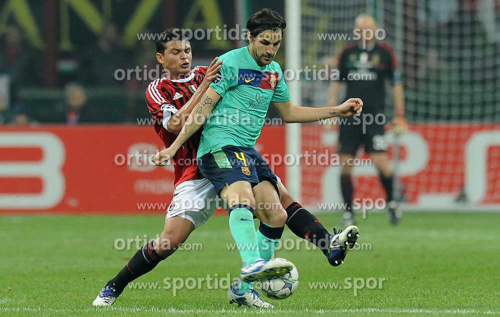 23.11.2011, Giuseppe Meazza Stadion, Mailand, ITA, UEFA CL, Gruppe H, AC Mailand (ITA) vs FC Barcelona (ESP), im Bild THIAGO SILVA (Milan), Cesc FABREGAS (Barcellona) // during the football match of UEFA Champions league, group H, between Gruppe H, AC Mailand (ITA) and FC Barcelona (ESP) at Giuseppe Meazza Stadium, Milan, Italy on 2011/11/23. EXPA Pictures © 2011, PhotoCredit: EXPA/ Insidefoto/ Alessandro Sabattini..***** ATTENTION - for AUT, SLO, CRO, SRB, SUI and SWE only *****