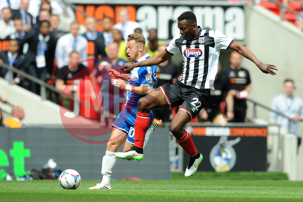 Bristol Rovers' Matt Taylor challenges for the ball with Grimsby's Aristote Nsiala - Photo mandatory by-line: Dougie Allward/JMP - Mobile: 07966 386802 - 17/05/2015 - SPORT - football - London - Wembley Stadium - Bristol Rovers v Grimsby Town - Vanarama Conference Football