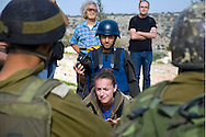 Every Friday afternoon since 2005, residents of the Palestinian village of Bil&rsquo;in, joined by Israeli and international activists, have protested the Israeli-built separation barrier that separates the village from approximately 60 percent of its agricultural land. A documentary about the protest, 5 Broken Cameras, was nominated for an Academy Award in 2013.<br />