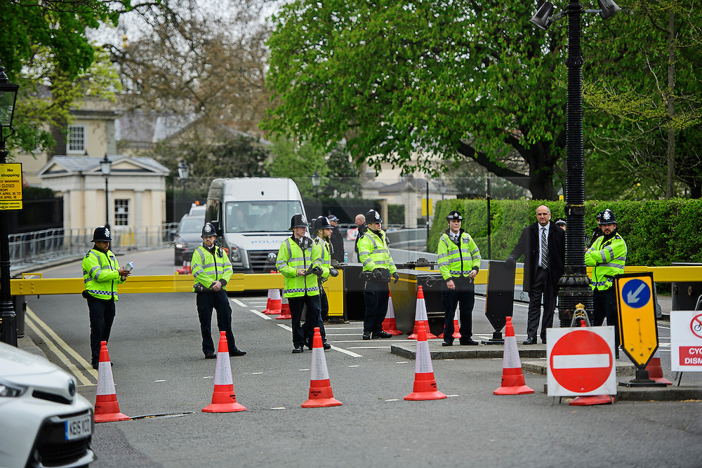 © London News Pictures. 22/04/2016. London, UK. british price (left) and a member of the secret service (right). Heightened security surrounding the residence of the US Ambassador to the United Kingdom in Regents Park, London, where the President of the United States Barak Obama is staying during his visit to the UK. Photo credit: Ben Cawthra/LNP