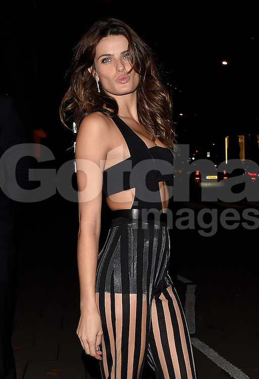 Isabeli Fontana attends the Chopard Christmas Party at Annabel's in Mayfair, London, UK. 02/12/2014<br />BYLINE MUST READ : GOTCHAIMAGES.COM<br /><br />Copyright by &copy; Gotcha Images Ltd. All rights reserved.<br />Usage of this image is conditional upon the acceptance <br />of Gotcha Images Ltd, terms and conditions available at<br />www.gotchaimages.com