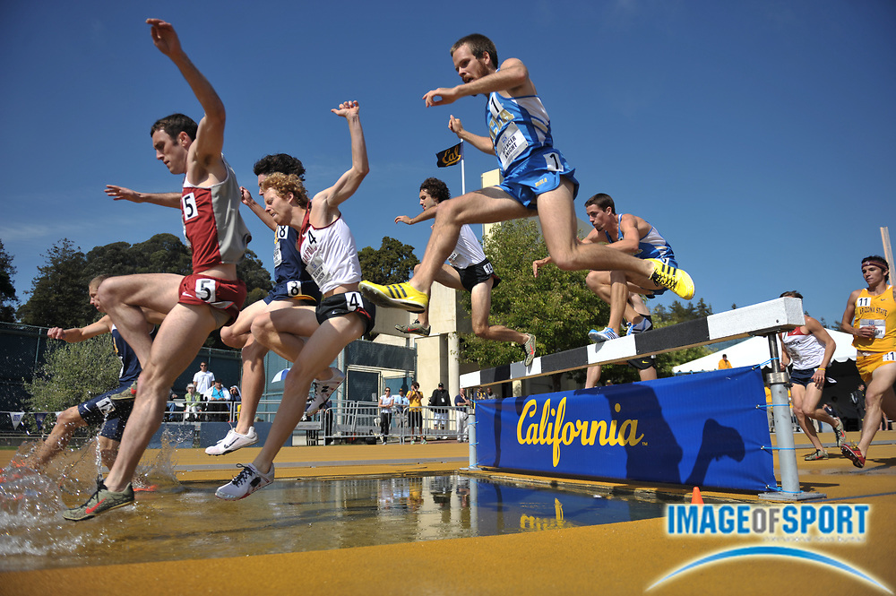 May 15, 2010; Berkeley, CA, USA; Runners negotiate the water jump in the steeplechase in the 2010 Pacific-10 Conference Track and Field Championships at Edwards Stadium.