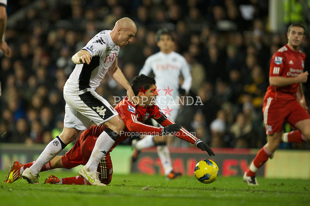 LONDON, ENGLAND - Monday, December 5, 2011: Liverpool's Luis Alberto Suarez Diaz is fouled by Fulham's Philippe Senderos during the Premiership match at Craven Cottage. (Pic by David Rawcliffe/Propaganda)
