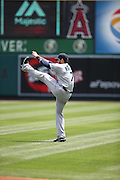 ANAHEIM, CA - JULY 20:  Stefen Romero #7 of the Seattle Mariners stretches before the game against the Los Angeles Angels of Anaheim at Angel Stadium on Sunday, July 20, 2014 in Anaheim, California. The Angels won the game 6-5. (Photo by Paul Spinelli/MLB Photos via Getty Images) *** Local Caption *** Stefen Romero