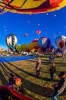 View from a hot air balloon lifting off, Balloon Fiesta Park, Albuquerque International Balloon Fiesta, Albuquerque, New Mexico USA.