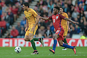 Tomas Rogic (Australia) runs away from Raheem Sterling (England) during the Friendly International match match between England and Australia at the Stadium Of Light, Sunderland, England on 27 May 2016. Photo by Mark P Doherty.