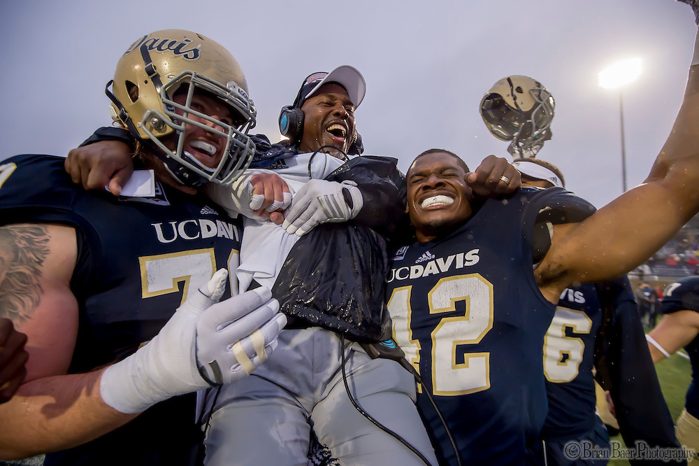 UC Davis Aggies head coach Ron Gould is carried off the field by his team following their 48-30 victory over the Sacramento State Hornets in the Causeway Classic,  Saturday Nov 19, 2016.<br /> photo by Brian Baer