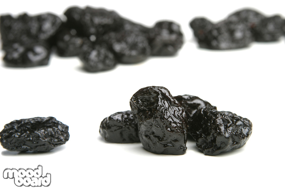 Studio shot of prunes on white background
