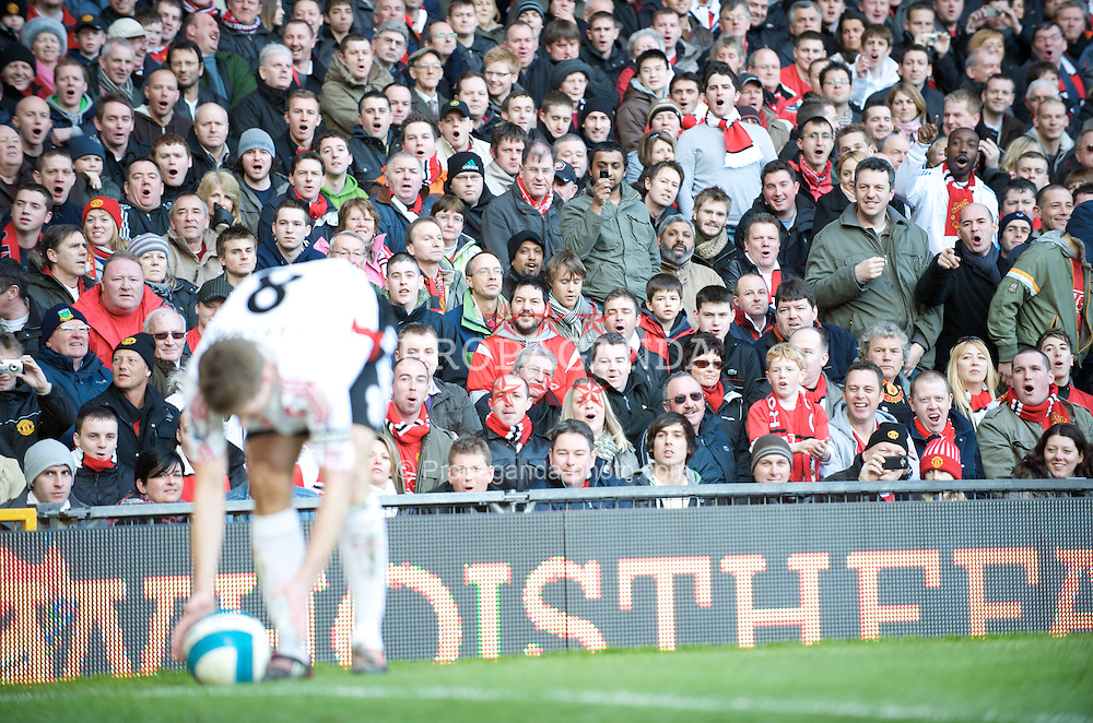 MANCHESTER, ENGLAND - Sunday, March 23, 2008: Manchester United's fans are facinated by Liverpool captain Steven Gerrard's backside during the Premiership match at Old Trafford. (Photo by David Rawcliffe/Propaganda)