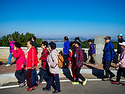 PAJU, GYEONGGI, SOUTH KOREA:  South Korean tourists arrive at the Odusan Unification Observatory, a South Korean tourist attraction that overlooks the DMZ. Tourism to the Korean DeMilitarized Zone (DMZ) has increased as the pace of talks between South Korea, North Korea and the United States has increased. Some tours are sold out days in advance.     PHOTO BY JACK KURTZ