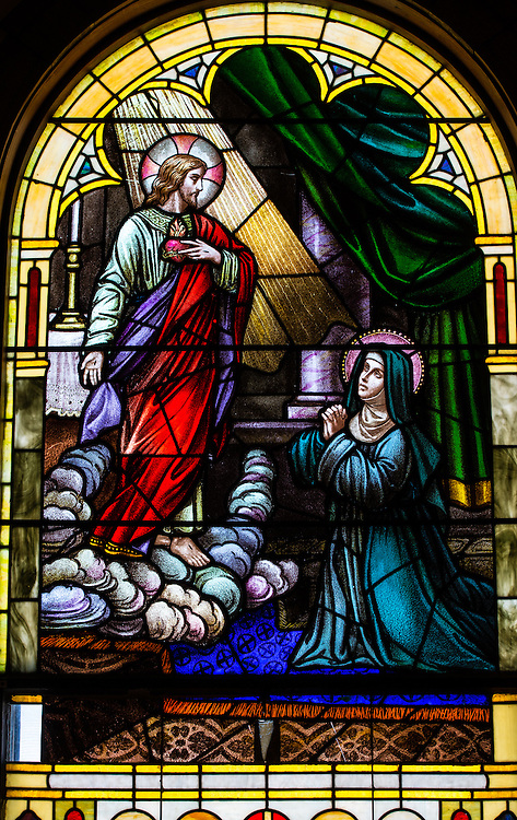 Stained glass image from St. Joseph Church in Kellnersville, Wis., depicts Jesus holding his Sacred Heart while appearing to Saint Margaret Mary Alacoque. (Sam Lucero photo)