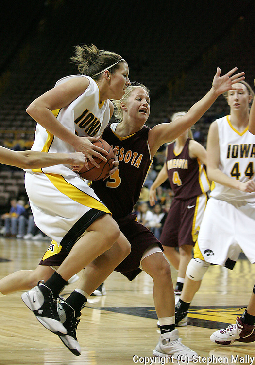 25 JANUARY 2007: Iowa forward Wendy Ausdemore (32) drives to the basket while being guarded by Minnesota guard Kelly Roysland (3) in Iowa's 80-78 overtime loss to Minnesota at Carver-Hawkeye Arena in Iowa City, Iowa on January 25, 2007.