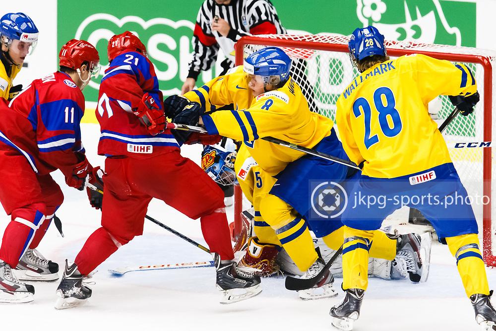 140104 Ishockey, JVM, Semifinal,  Sverige - Ryssland<br /> Icehockey, Junior World Cup, SF, Sweden - Russia.<br /> Linus Arnesson, (SWE) keeps Alexander Barabanov, (RUS) away from the goal.<br /> Linus Arnesson, (SWE) h&aring;ller Alexander Barabanov, (RUS) borta fr&aring;n m&aring;let.<br /> Endast f&ouml;r redaktionellt bruk.<br /> Editorial use only.<br /> &copy; Daniel Malmberg/Jkpg sports photo
