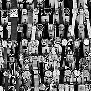 A wall of various watches for sale at one of many stores in Chinatown, NY.