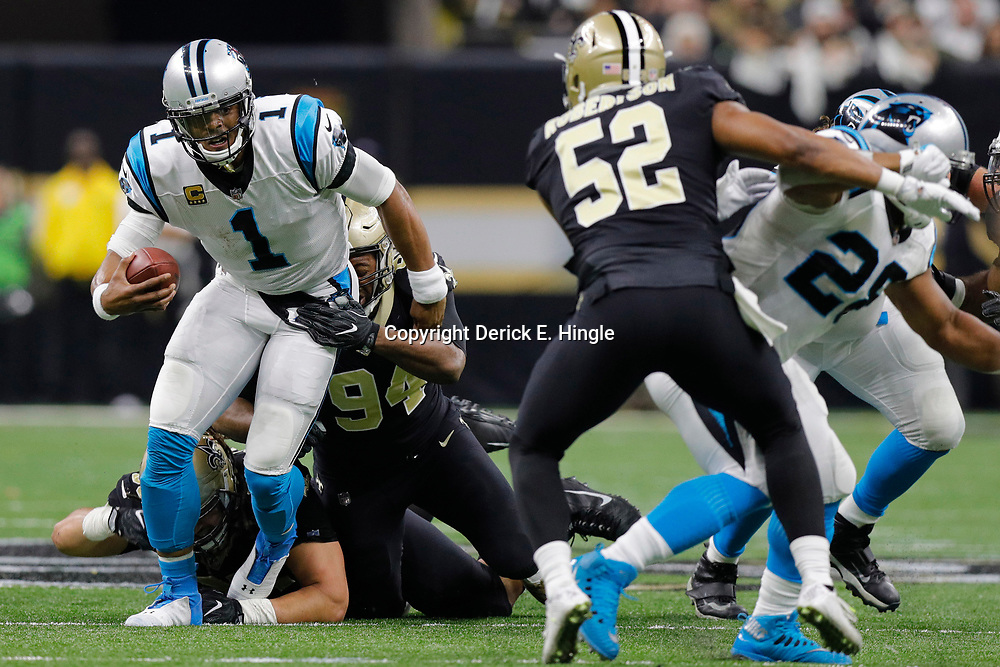 Jan 7, 2018; New Orleans, LA, USA; Carolina Panthers quarterback Cam Newton (1) is pulled down by New Orleans Saints defensive end Cameron Jordan (94) during the first quarter in the NFC Wild Card playoff football game at Mercedes-Benz Superdome. Mandatory Credit: Derick E. Hingle-USA TODAY Sports