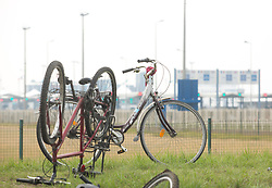 "© Licensed to London News Pictures. 30/08/2015. Calais, France. A bike from the solidarity ride by ""Critical mass to Calais"" stands outside Calais port. Around a hundred British cyclist arrived to Calais from London as they are to donate bicycles to the people in the refugee camp, also known as the Jungle, as well as supplies to support the life at the site. Photo credit : Isabel Infantes/LNP"
