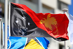 The flag of Papua New Guinea on a pole at the Commonwealth Games