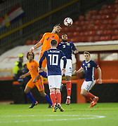 9th November 2017, Pittodrie Stadium, Aberdeen, Scotland; International Football Friendly, Scotland versus Netherlands; Holland's Karim Rekik competes in the air with Scotland's Matt Phillips