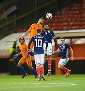 9th November 2017, Pittodrie Stadium, Aberdeen, Scotland; International Football Friendly, Scotland versus Netherlands; Holland's Karim Rekik competes in the air with Scotland's Matt Phillips