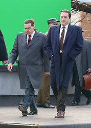 "Screen Legends Robert De Niro and Al Pacino are pictured filming their upcoming Martin Scorsese's Mob Drama ""The Irishman"" in the Bronx. De Niro wore high platform shoes in one of the scenes to make himself appear bigger next to Pacino. Ray Romano is also pictured next to the lengendary actors. 20 Dec 2017 Pictured: Al Pacino and Robert De Niro. Photo credit: LRNYC / MEGA TheMegaAgency.com +1 888 505 6342"