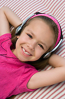 Little Girl Listening to Headphones