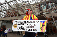 A support of Catalunia holding a flag asking why the catalans don't have option to vote.<br /> Members of different political ideal gather in the scottish parliament due what Today 18th September is the Scottish Referendum. Pako Mera/Universal News And Sport (Europe) 18/09/2014