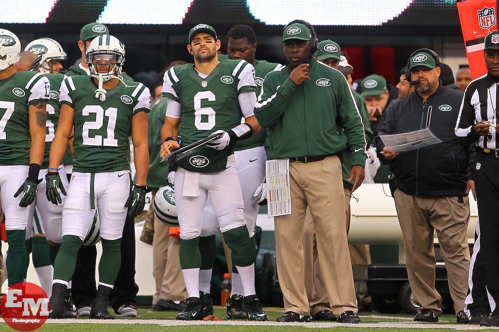 Dec 2, 2012; East Rutherford, NJ, USA; New York Jets quarterback Mark Sanchez (6) watches from the sideline after being benched for New York Jets quarterback Greg McElroy (14) during the second half at MetLIfe Stadium.