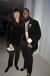 MR & MRS ORLANDO HAMILTON attending the Tag Heuer party where an exhibition of photographs by Mary McCartney celebrating 15 exception women from 15 countries was unveiled at the Royal College of Arts, Kensington Gore, London on 8th February 2007.<br />
