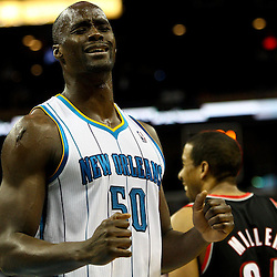 March 30, 2011; New Orleans, LA, USA; New Orleans Hornets center Emeka Okafor (50) reacts after a fouled is called during the third quarter against the Portland Trail Blazers at the New Orleans Arena. The Hornets defeated the Trail Blazers 95-91.   Mandatory Credit: Derick E. Hingle