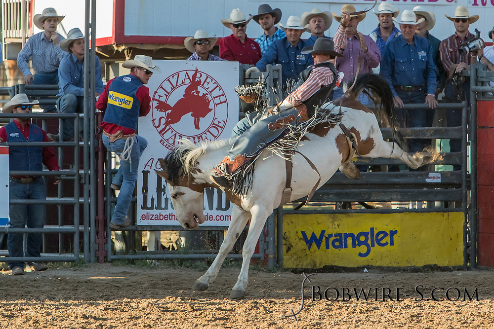 Bareback bronc rider Chance Ames rides Summit Pro Rodeo's Sangria in the second performance of the Elizabeth Stampede on Saturday, June 2, 2018.