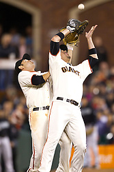 July 27, 2010; San Francisco, CA, USA;  San Francisco Giants second baseman Freddy Sanchez (back) collides with first baseman Travis Ishikawa (10) on an infield fly ball during the eighth inning against the Florida Marlins at AT&T Park.