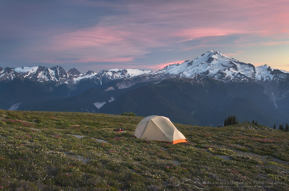 Backcountry camp high on Miner's Ridge, Glacier Peak in the Distance, Glacier Peak Wilderness North Cascades Washington.<br /> <br /> Glacier Peak (10,541′) or Dakobed is the most isolated of the five major stratovolcanoes of the Cascade Volcanic Arc.