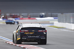September 27, 2018 - Concord, North Carolina, United States of America - Brendan Gaughan (3) races down the back straightaway during practice the Drive for the Cure 200 at Charlotte Motor Speedway in Concord, North Carolina. (Credit Image: © Chris Owens Asp Inc/ASP via ZUMA Wire)
