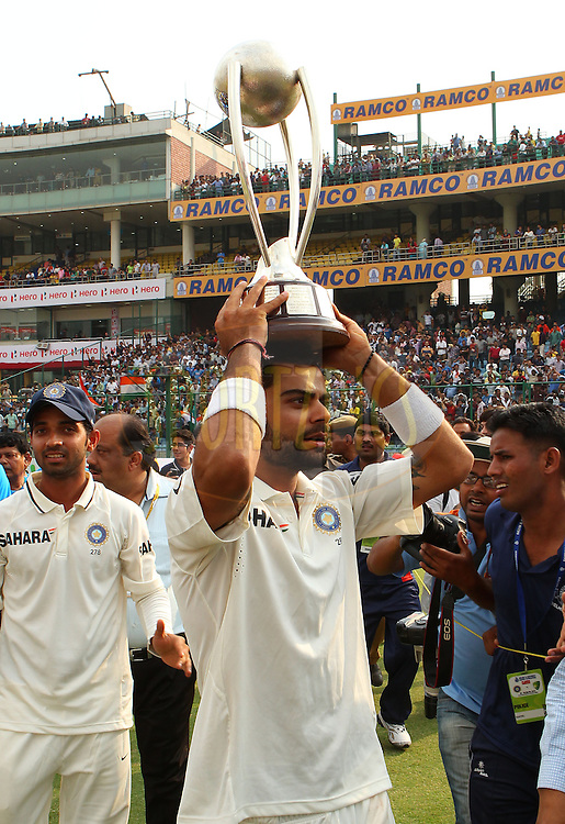 Virat Kohli of India with the Border Gavaskar trophy during day 3 of the 4th Test Match between India and Australia held at the Feroz Shah Kotla stadium in Delhi on the 24th March 2013..Photo by Ron Gaunt/BCCI/SPORTZPICS ..Use of this image is subject to the terms and conditions as outlined by the BCCI. These terms can be found by following this link:..http://www.sportzpics.co.za/image/I0000SoRagM2cIEc