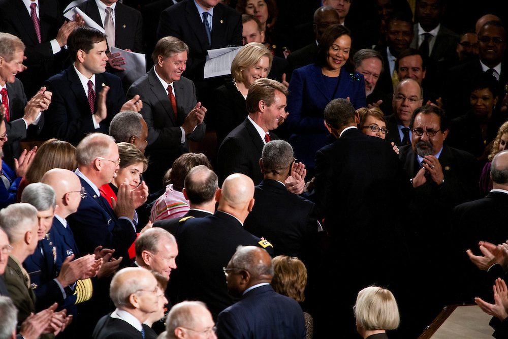 President Barack Obama hugs former Rep. Gabrielle Giffords (D-AZ) at his State of the Union address in the U.S. Capitol on Tuesday, January 24, 2012 in Washington, DC.