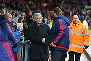 Stoke City Manager Mark Hughes shakes the hands of Manchester United Manager Louis van Gaal during the Barclays Premier League match between Manchester United and Stoke City at Old Trafford, Manchester, England on 2 February 2016. Photo by Phil Duncan.