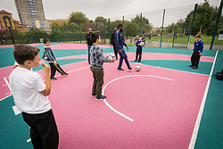Homes for Haringey & Keepmoat Regeneration community event, London Borough of Haringey, London UK - children playing football