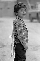 Young Palestinian boy with wooden toy gun in  Shatila refugee camp, Beirut, Lebanon 5 May 1982