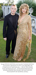 Singer RONAN KEATING and his wife YVONNE KEATING, at a party in Berkshire on 27th June 2002.	PBK 143