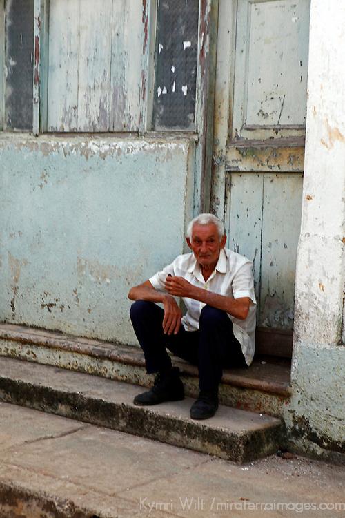 Central America, Cuba, Remedios. Older Cuban man sitting on steps in Renedios.