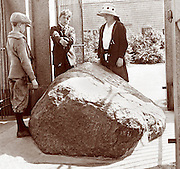 Vintage Image:  A family of tourists at the Plymouth Rock monument, circa 1900 Keystone View commemorating the 1620 landing of  English Puritans in Plymouth Massachusetts.