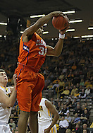 November 29, 2011: Clemson Tigers forward/center Devin Booker (31) pulls down a rebound during the first half of the NCAA basketball game between the Clemson Tigers and the Iowa Hawkeyes at Carver-Hawkeye Arena in Iowa City, Iowa on Tuesday, November 29, 2011. Clemson defeated Iowa 71-55 in the Big Ten-ACC Challenge game.