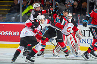 KELOWNA, CANADA - OCTOBER 28: Joel Lakusta #4 of the Prince George Cougars stick checks Leif Mattson #28 of the Kelowna Rockets in front of the net of Taylor Gauthier #35 of the Prince George Cougars on October 28, 2017 at Prospera Place in Kelowna, British Columbia, Canada.  (Photo by Marissa Baecker/Shoot the Breeze)  *** Local Caption ***