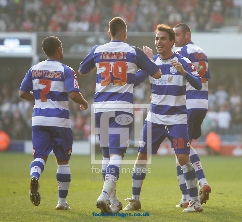 London - Saturday March 21st, 2009: Adel Taarabt of QPR celebrates scoring his side's second goal with team mate Jordi Lopez (R) during the Coca Cola Championship match at Loftus Road, London. (Pic by Mark Chapman/Focus Images)