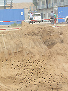 XINZHENG, CHINA - <br /> <br /> Construction Suspended For Protecting Swallow<br /> <br /> Thousands of nests of Sand Martin (Riparia riparia), a type of swallow, are seen at a construction site  in Xinzheng, Henan Province of China. To protect thousands of Sand Martin feeding their broods, local government consulted with the real estate developer, and the developer agreed to suspend the construction. <br /> ©Exclusivepix