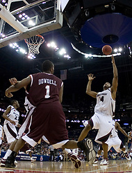 Southern Illinois Salukis forward Randal Falker (14) grabs a rebound in action against VT.  The #4 seed Southern Illinois Salukis defeated the #5 seed Virginia Tech Hokies 63-48 in the second round of the Men's NCAA Basketball Tournament at the Nationwide Arena in Columbus, OH on March 18, 2007.
